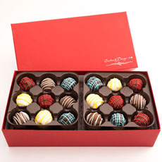 Our decadent assorted gourmet chocolate truffles are a treat that you don't want to miss! Impress your gift recipient with a 36 count box of hand dipped, perfectly baked, chocolate filled truffles that they can truly enjoy to the core. This colorful box of chocolates will be a great addition to any occasion and celebration for any true chocolate lover!
